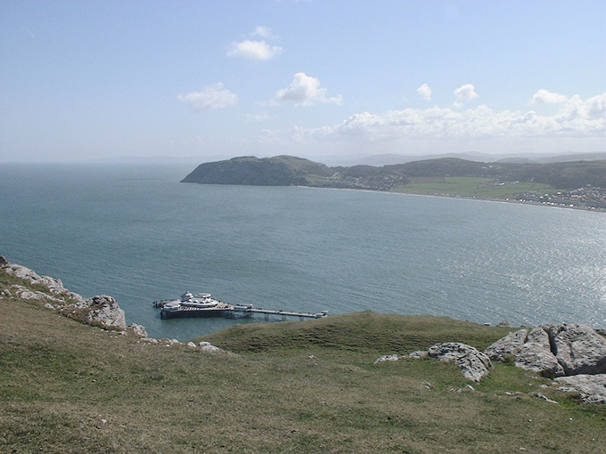 an image of Little Orme and pier