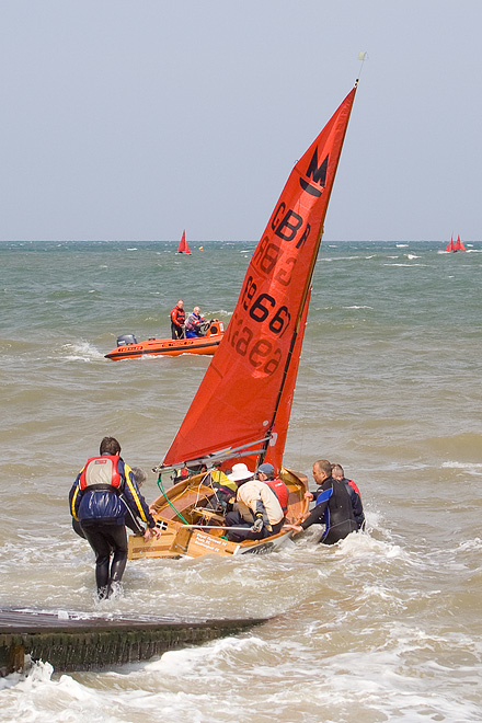 an image of Launching a sailing boat